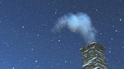 House chimney with smoke at snowfall night Footage