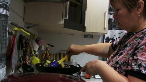 Woman Preparing Food In The Pan Footage