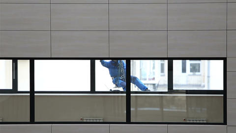 A window cleaner washes a window Footage