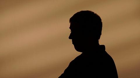 Male silhouette raising his shoulders Footage