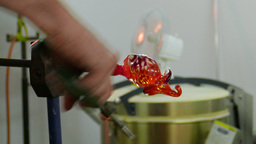Glassworks. Glass workshop. Artist is carving elephant from glass Live Action