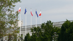 Polish And European Union Flags In Front Of Parliament Building In Warsaw stock footage