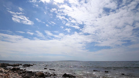Sea Lapping Rocky Coast, Spectacular Sky Sun stock footage
