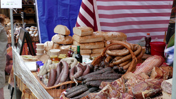 Open food market. Stand with bread, honey and sausage. Local traditional food Footage