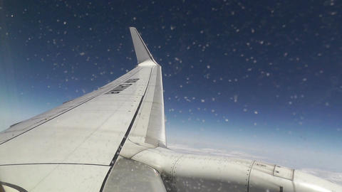 View at Airplane Engine and Wing through Icy Window air... Stock Video Footage