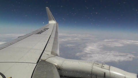View at Airplane Engine and Wing through Icy Window air china handheld Footage