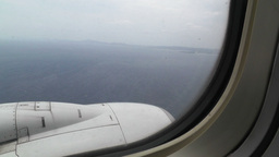 View at Airplane Engine over Sea 02 handheld Stock Video Footage