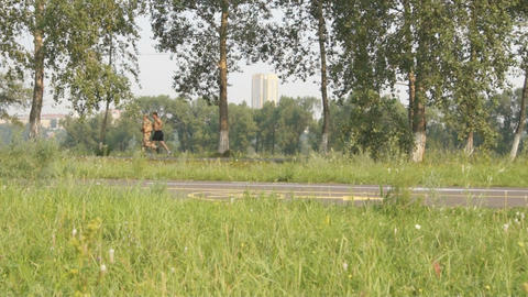 Two Men Running in the Park Stock Video Footage