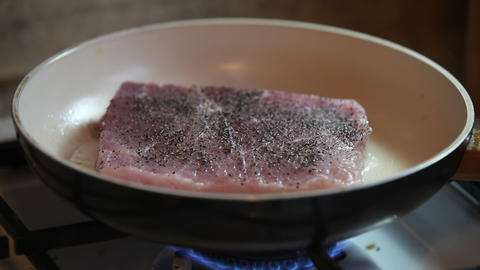 Pork chop frying on the pan Stock Video Footage