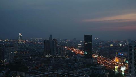 BANGKOK, THAILAND - APRIL 2015: Time lapse view of Bangkok skyline at sunset Footage