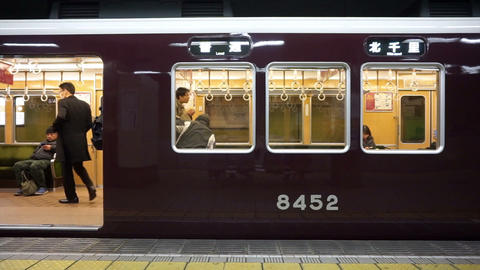 OSAKA, JAPAN - MARCH 2015: people waiting for new train at station in Japan Live Action