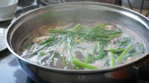 Hot pot of Vegetable and meat soup boiling in stove Footage