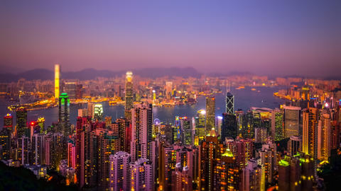 Tilt shift. Hong Kong skyline aerial view at sunset. Time lapse Footage