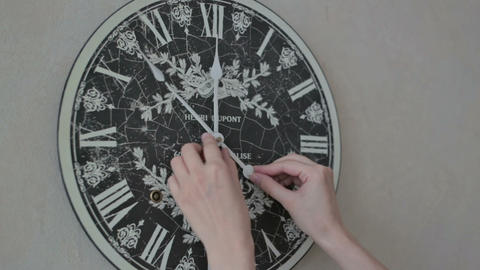 Woman hands turn clock arrow Footage