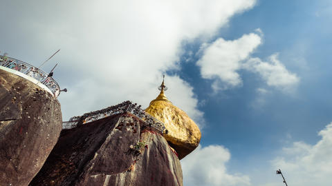 Golden Rock with traditional wind bells under blue sky. Myanmar. Time lapse Footage