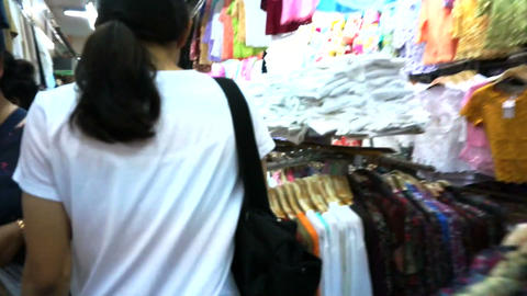 CHIANGMAI, THAILAND - April 2015: Fast forward girl walking though Warorot Marke Footage