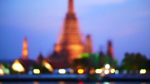 Wat Arun, Temple of The Dawn, Thailand at dusk filming defocus and tradition to  Footage
