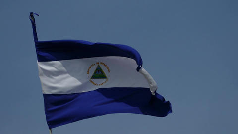 National flag of Nicaragua at bleu sky Footage