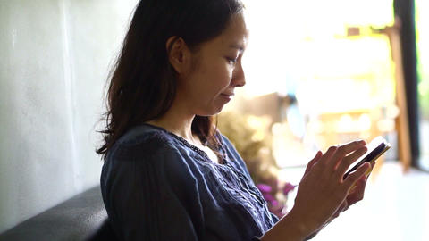 Asian girl using app on smartphone Footage