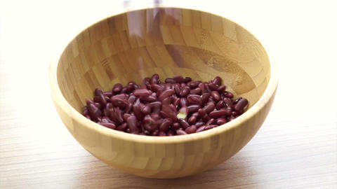 Red beans pouring to fill the wooden bowl, vegetarian multi grain protein food Footage