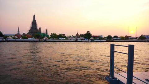 Wat Arun at Sunset, Temple of the Dawn in Bangkok, Thailand, Chao Phraya River.  Footage