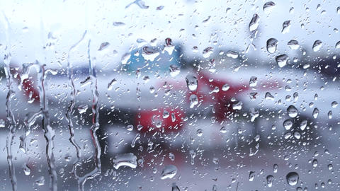 Raindrops on the air plane window with blur airport outside HD Footage