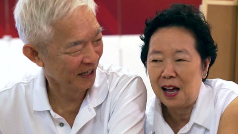 happy senior asian couple playing and have fun with humor Footage