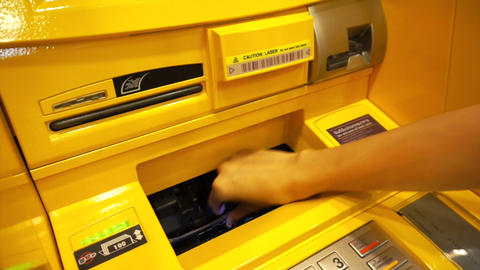 Woman's hand taking money from ATM Footage