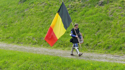 Medieval knight from Belgium walk with flag. Slow motion Live Action