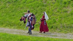 Medieval knight carries his armor. Slow motion Live Action