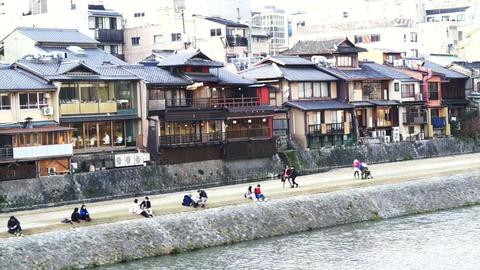 Kyoto, Japan - March 2015: Riverside in Kyoto, Japan with lot of architectures a Live Action