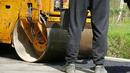 Road Construction - Road Roller Compacting Ground stock footage