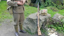 WW2 Soldier On Guard With Paramedic Band On His Arm stock footage