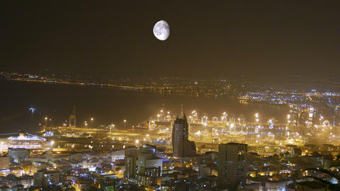 Traffic. Moon over the city. Time lapse. Haifa. Israel Footage