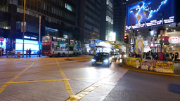 Looking on the fast moving double-decker bus, night, some junction of HongKong Footage