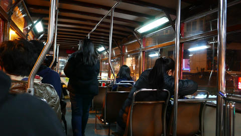 Passengers Boarding To Second Deck Of Old-fashioned Tram, Night Time stock footage