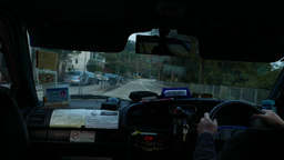 View from moving taxi car in front direction, twilight time, forest road Footage