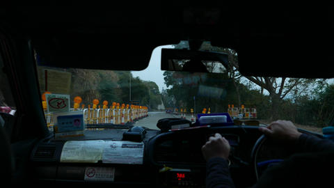 Driving around road construction area, evening, view from inside car Footage