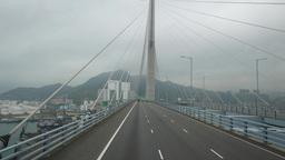 Drive through futuristic cable-stayed bridge, hypnotize hawser lines Live Action