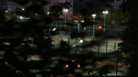 Tennis courts area at private residential area, surrounded with park Footage