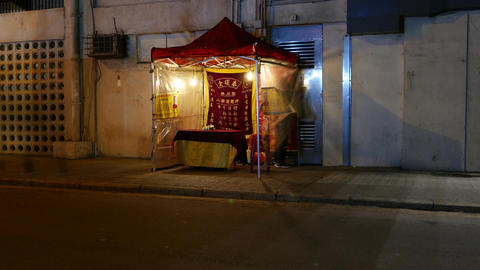 Fortune teller prepare to work: setting up kiosk on night street, timelapse Live Action
