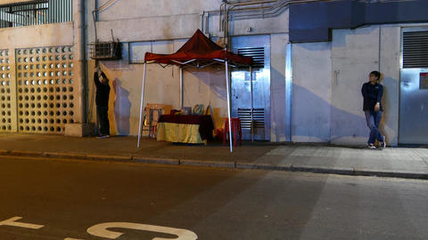 Man set up divination stall on night street, turn lights on, Timelapse Live Action