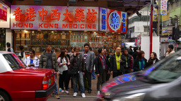 Pedestrians And Blinking Signboard On The Background, HongKong stock footage
