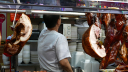 Cooked meat street store and seller serves the client Footage