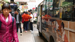 Faces on of the typical HongKong street, walking forward, FPV Footage