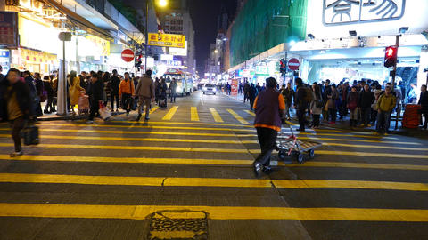 T-view road cross, crowd of people on pedestrian crossing at night time Footage