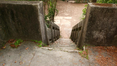 Walking down by mossy concrete staircase, old and forsaken Stock Video Footage