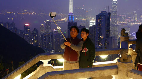 Father and son make selfie against amazing night Hong... Stock Video Footage