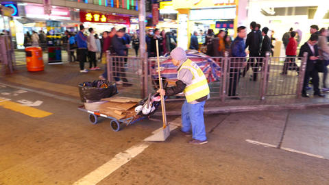 granny-cleaner on the busy street of HongKong Stock Video Footage