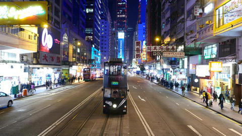 Double decker tram approach and stops in front, night... Stock Video Footage